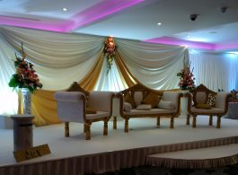 Asian weddings - seating stage gold and cream - IBIS Forum Venue Stevenage