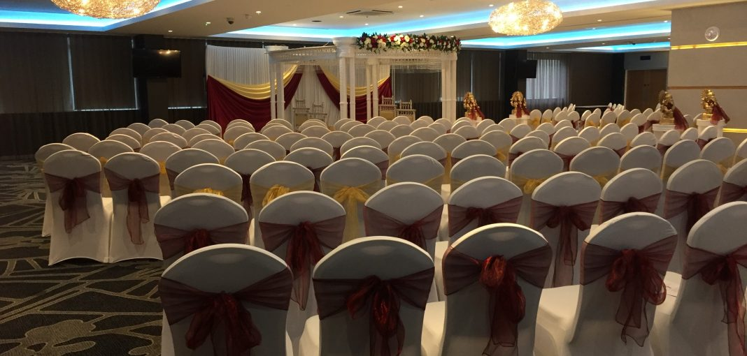 Asian weddings - seating red and gold decor - IBIS Forum Venue Stevenage